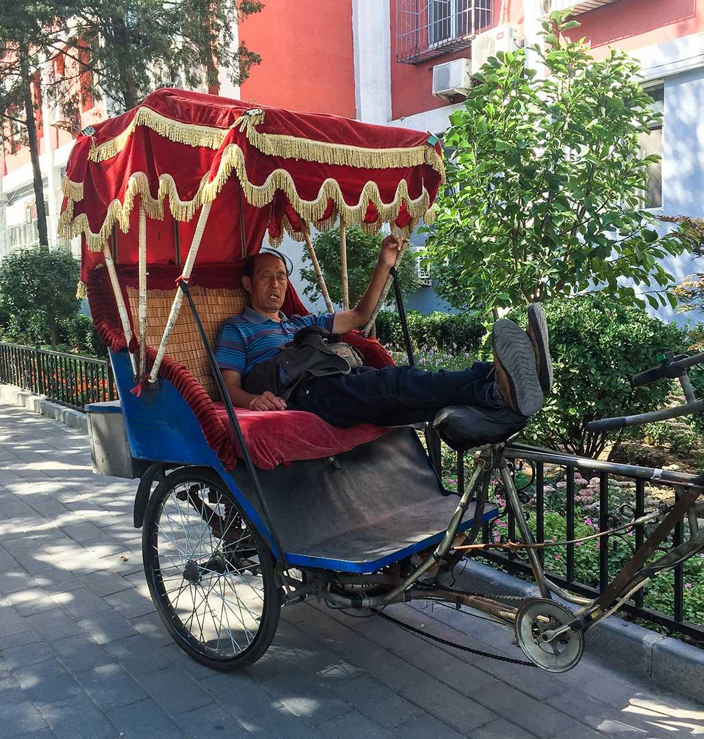 Napping Rickshaw Driver