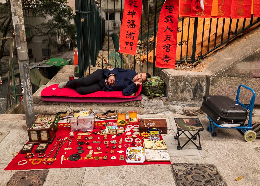 Hong Kong - Sleeping street vendor
