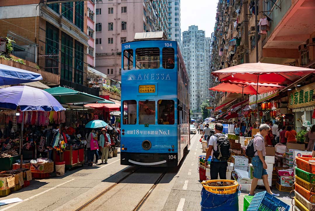 Hong Kong - Tram going through a Street Market