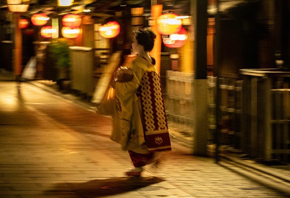 Geisha walking between teahouses