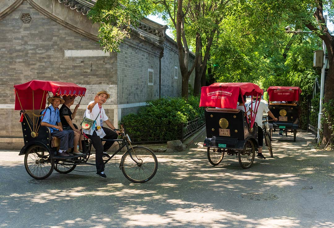 Pedicab tours taking tourists around the Hutongs and the lakes