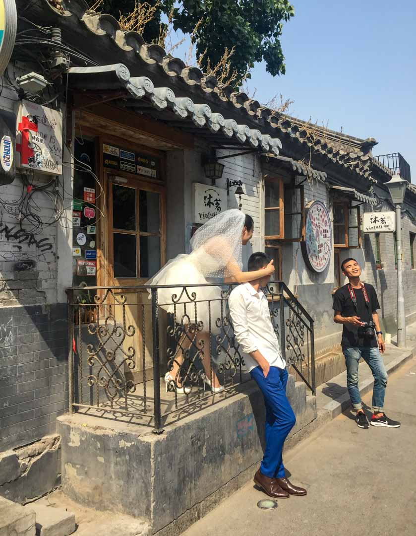 Wudaoying Hutong - Couple posing for wedding photos with Photographer