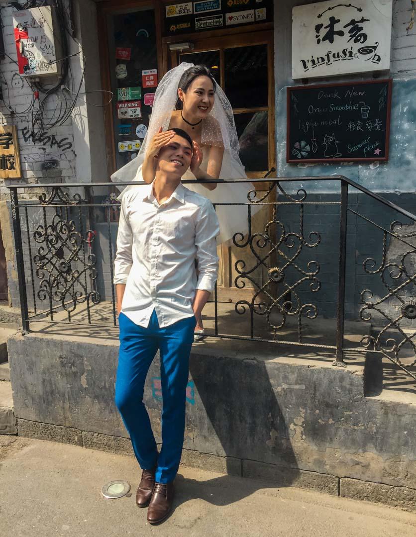 Wudaoying Hutong - Young couple posing for wedding photos